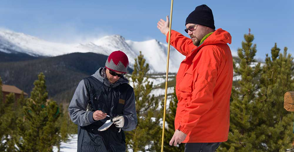 measuring snowfall in the Rocky Mountains