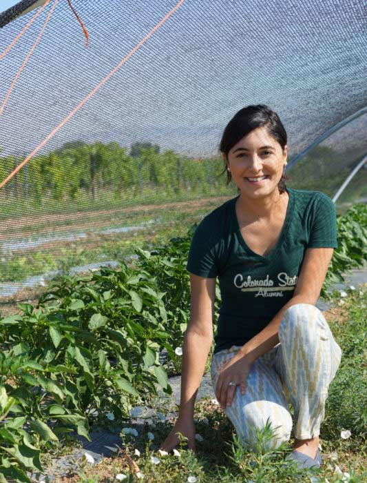 Student, Aisha Martinek working firsthand in the field for research.