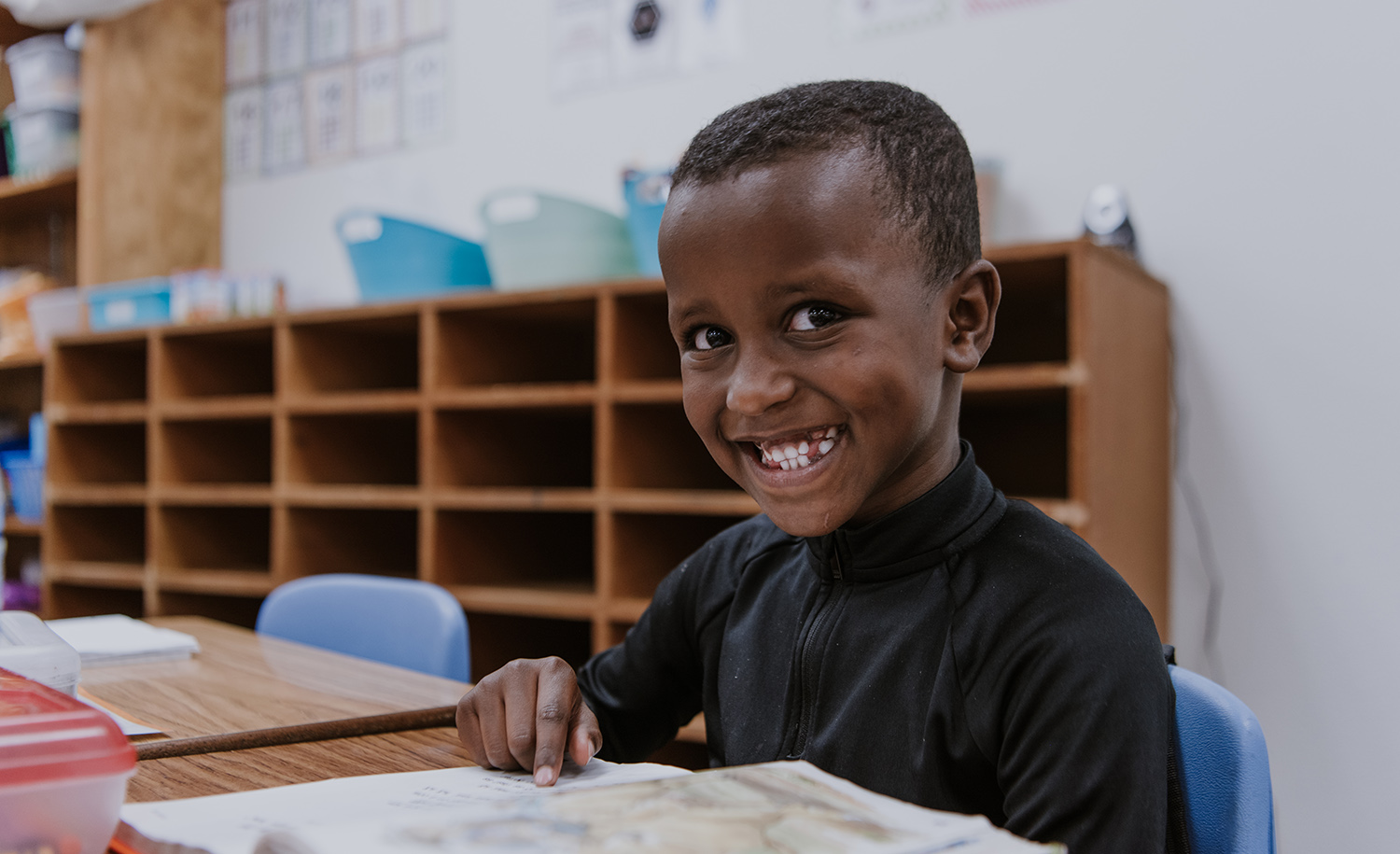 A smiling elementary school student.